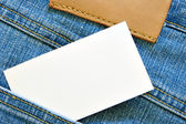 Visiting card in jeans pocket — Stock Photo