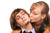 Young girl kissing young handsome guy — Stock Photo