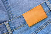 Jeans with blank label — Stock Photo