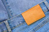 Kot pantolonla boş etiket — Stok fotoğraf