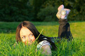 Woman lie on grass — Stock Photo