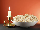 Candle and matzoh — Stock Photo