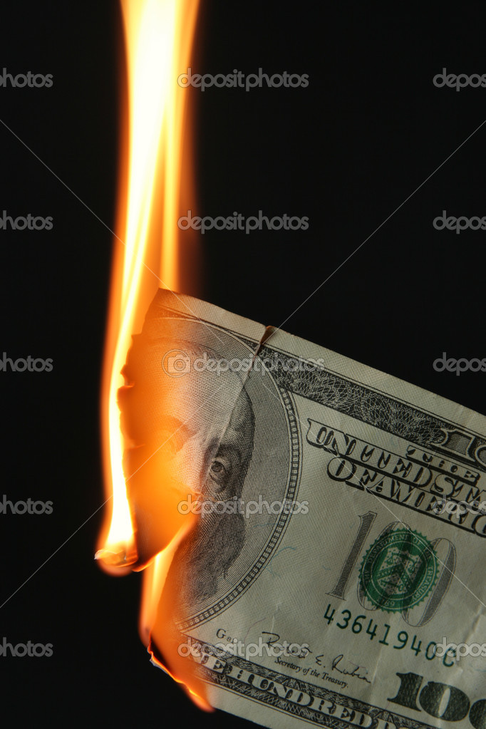 Burning dollars close up over black background — Lizenzfreies Foto #1440799
