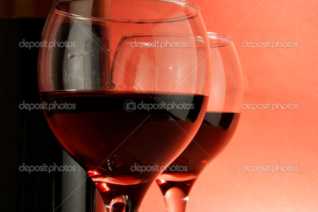 Two glasses of red wine over deep red background — Stock Photo #1440876