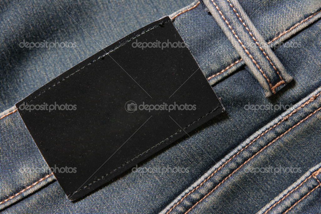 Jeans with blank black label - put your own text here — Stock Photo #1441002