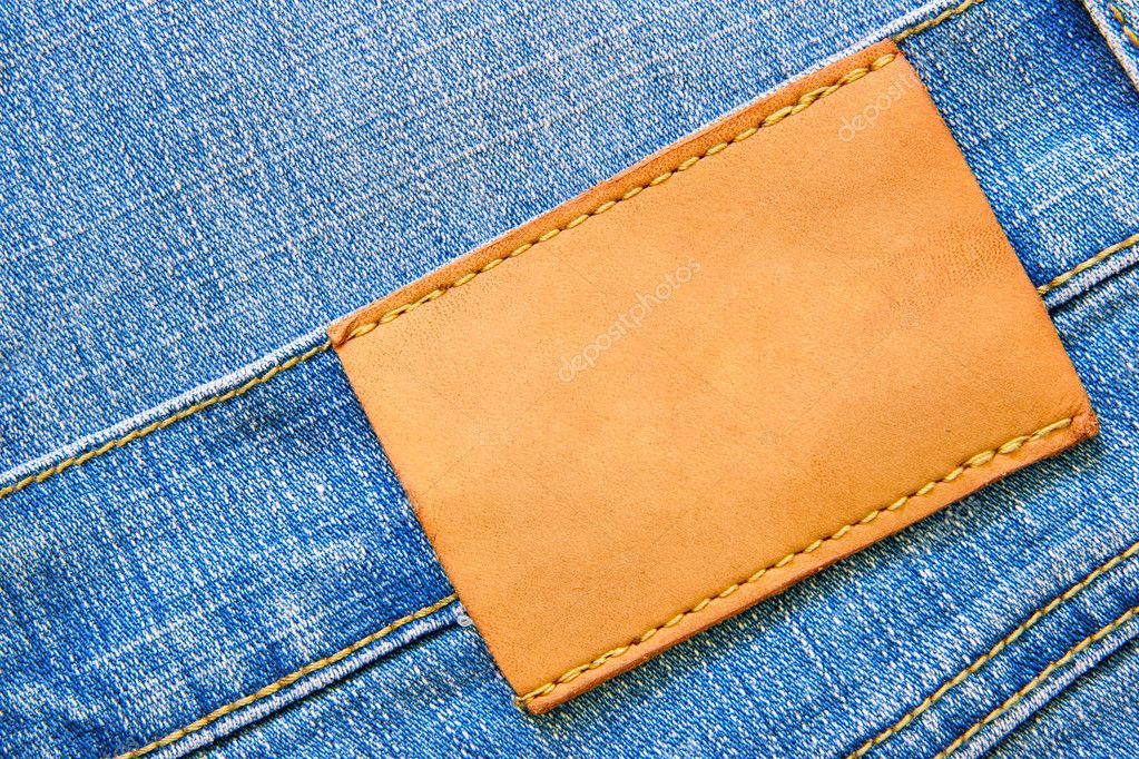 Blue jeans with blank leather label for your own text — Stock Photo #1441403