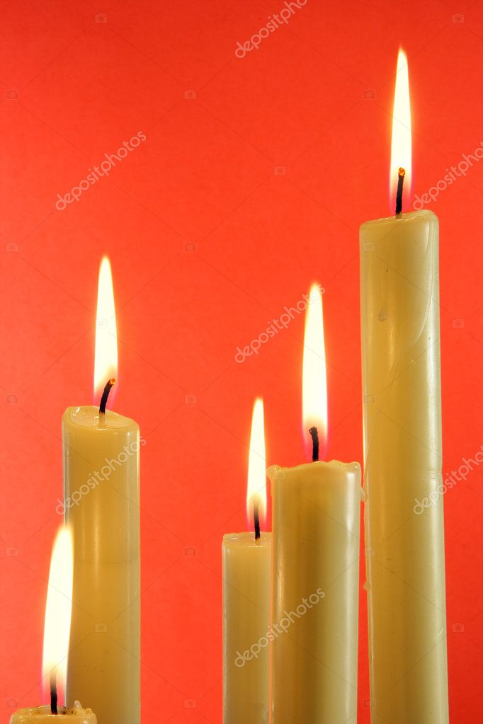 Five burning candles over light red background  Photo #1445776