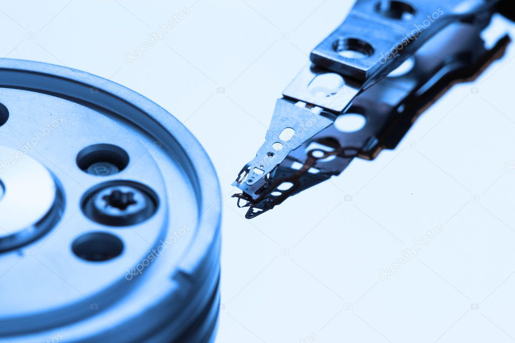 Opened hard disk drive colose-up toned in blue color — Stock Photo #1446199
