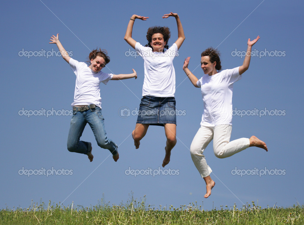 Three girls jump against a deep blue sky  Stock Photo #1446313