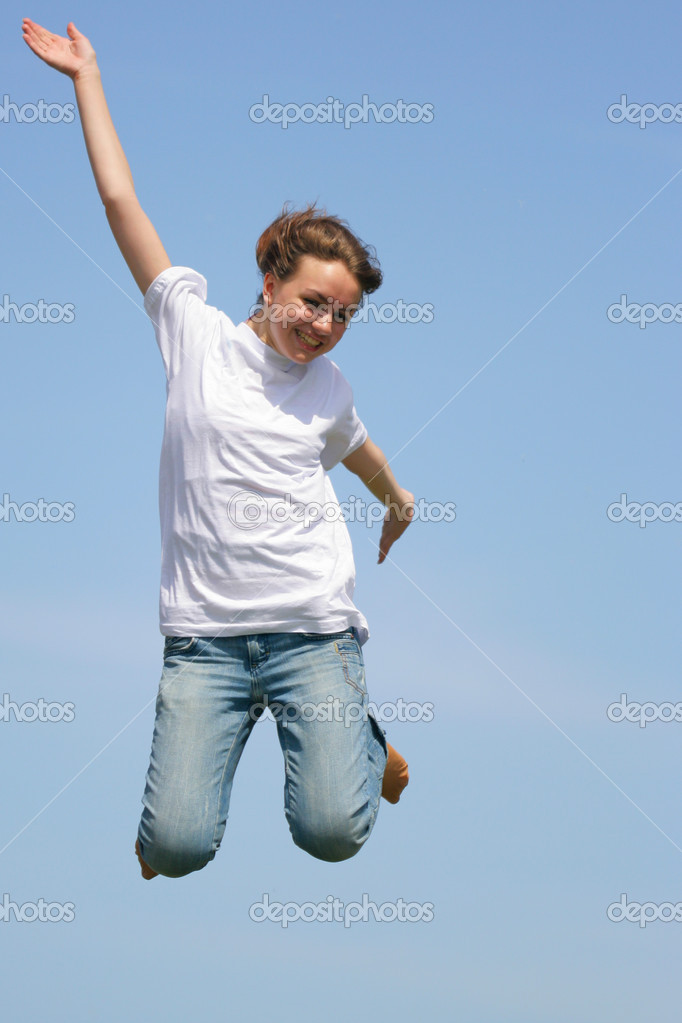 Young girl jump against a blue sky — Stock Photo #1446377
