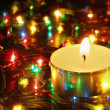 Candle and garland lights - Stock Photo