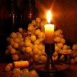 Grapes and candle — Stock Photo #1450642