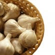 Basketful of garlic — Stock Photo