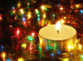 Candle and garland lights — Stock Photo