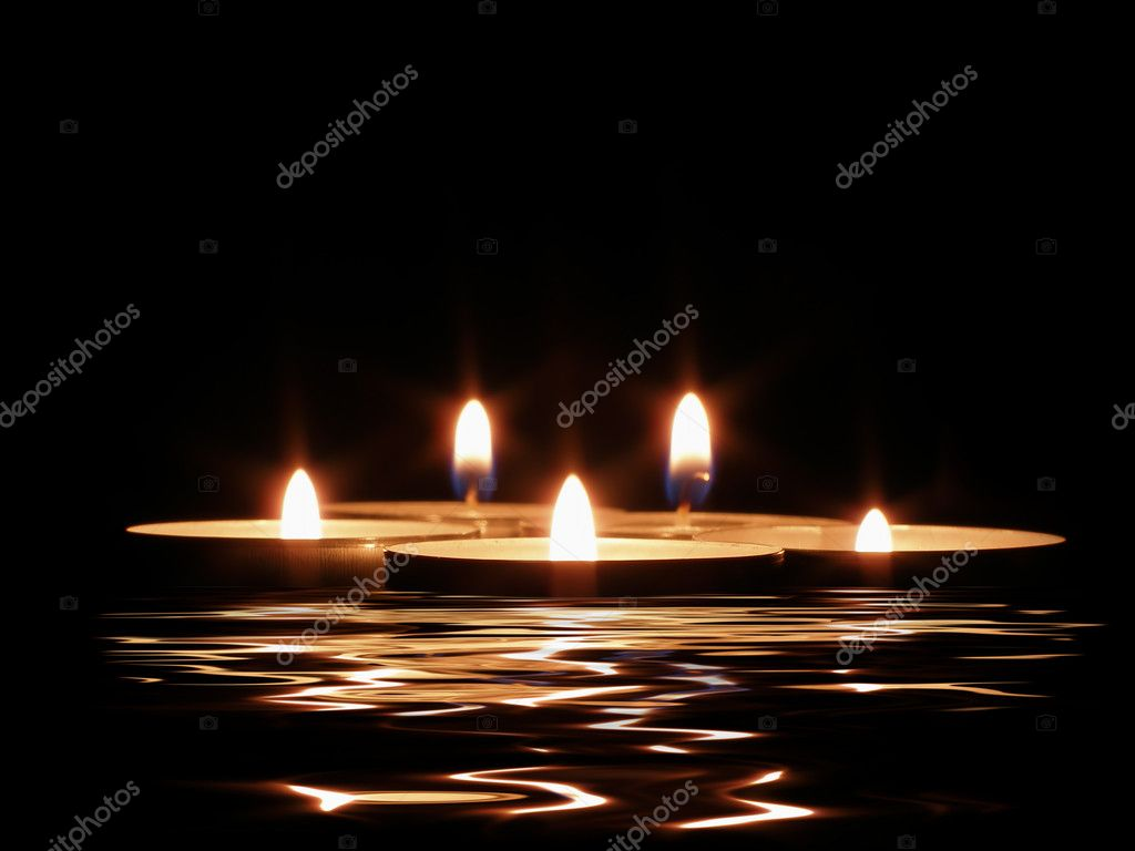 Candles and its reflection in dark water         — 图库照片 #1450589