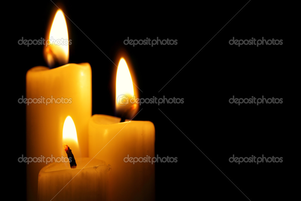 Three burning candles over a black background — Stock Photo #1475134