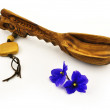 Stock Photo: Wooden cooking spoon and blue flowers