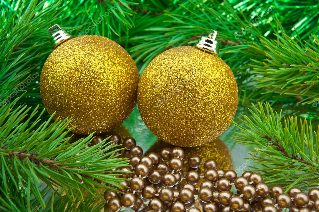 New year toy ball on a gold background  Stock Photo #1410714
