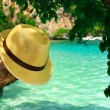 Sea, beach, summer hat - Stock Photo