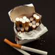 Nasty  open pack cigarettes - Stock Photo