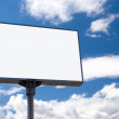 White bill board advertisement under sky - Stock Photo