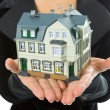 Hand with little house — Stock Photo #1209642