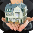 Hand with little house — Stock Photo