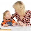 Stock Photo: Pretty baby and mother draw color penci
