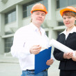 Architects man and woman  protective hel — Stock Photo