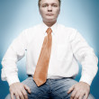 Young businessman in white shirt and ora — Stock Photo