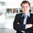 Стоковое фото: Happy young businessman portrait