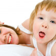 Mother an baby in bed — Stock Photo