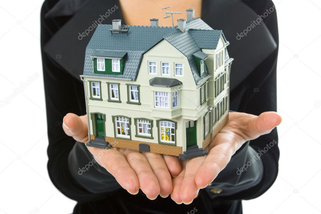 Woman hand with little house — Stock Photo #1209642