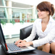 Young business woman work on laptop - Stock Photo
