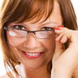 Close-up  businesswoman in glasses - Stock Photo