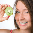 Beauty woman with kiwi — Stock Photo