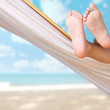 Stock Photo: Child legs on hammock