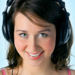 Pretty girl in head phones — Stock Photo