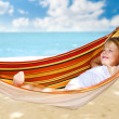 Child relaxing in a hammock — Stok fotoğraf