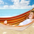 Child relaxing in a hammock - Stok fotoğraf
