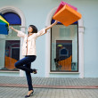 Young woman with multi-coloured bags - Stock Photo