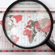 Stock Photo: Magnifier on world map with time zones