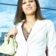 Businesswoman in the city — Stock Photo #1211049