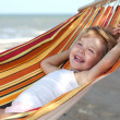 Child relaxing in a hammock - Stock Photo