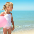 Child on coast of sea — Stock Photo