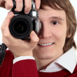 Stock Photo: Young photographer man