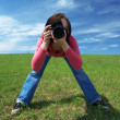 Woman photographer in field — Stock Photo