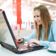 Young woman with laptop — Stock Photo #1212166