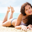 Beautiful brunette on vacation — Stock Photo