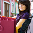 Young woman with multi-coloured bags — Stock Photo